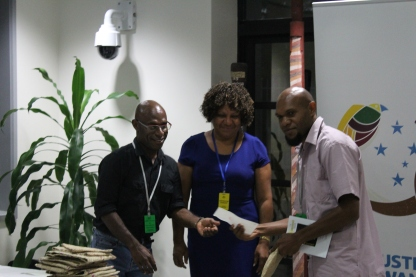 Emmanuel Peni and Carolyn Ive of Kina Securities Limited presenting the Crocodile Prize and the Cheque to Wardly D Barry-Igivisa